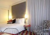 dormitorio coqueto harmoni hotel